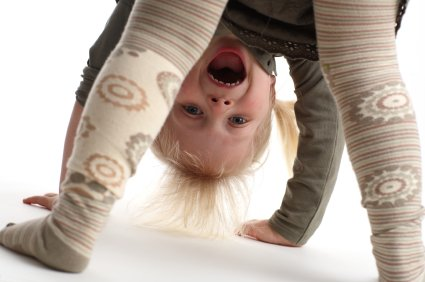 little girl learning to somersault