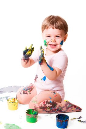 young toddler finger painting