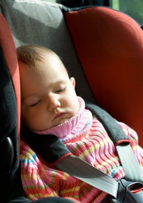 baby girl sleeping in carseat on a long car journey